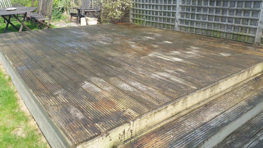 A decking area in dire need of cleaning and treating