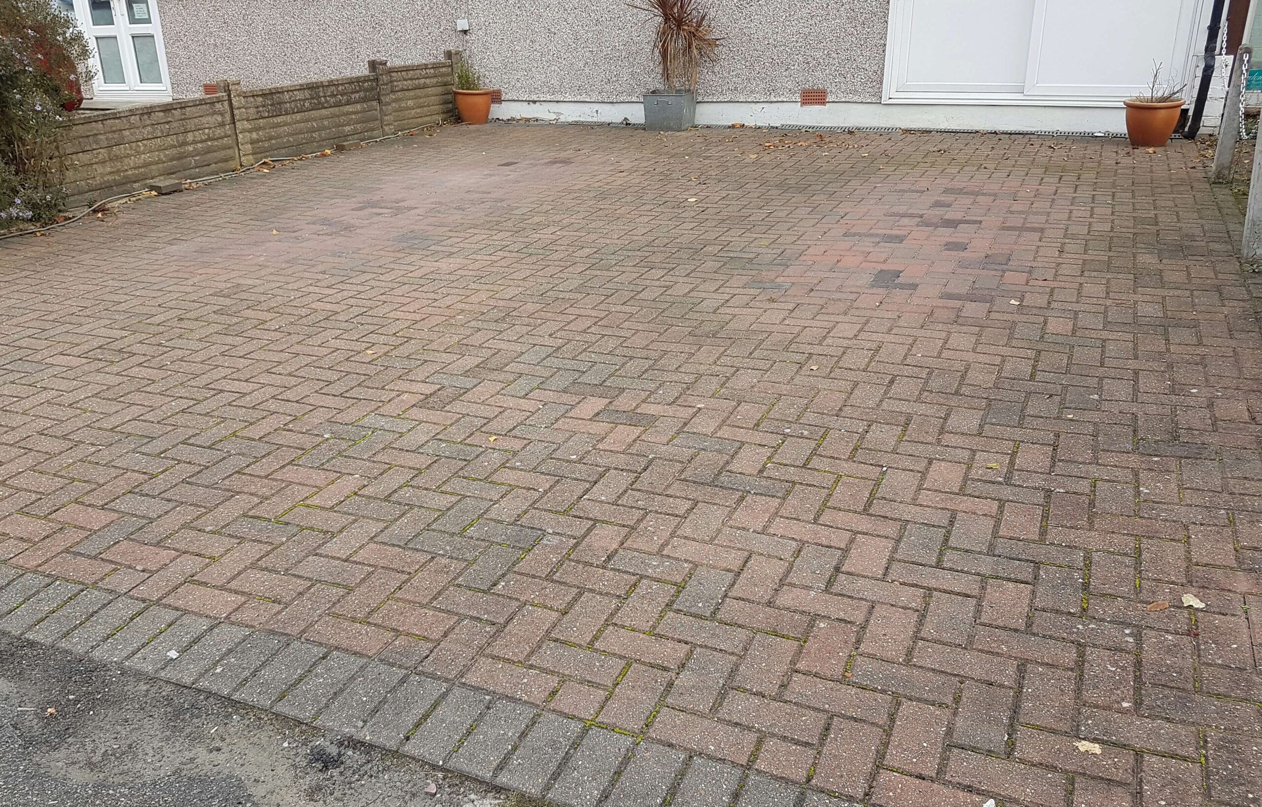 Clean Vehicle Patches On Block Pave Driveway