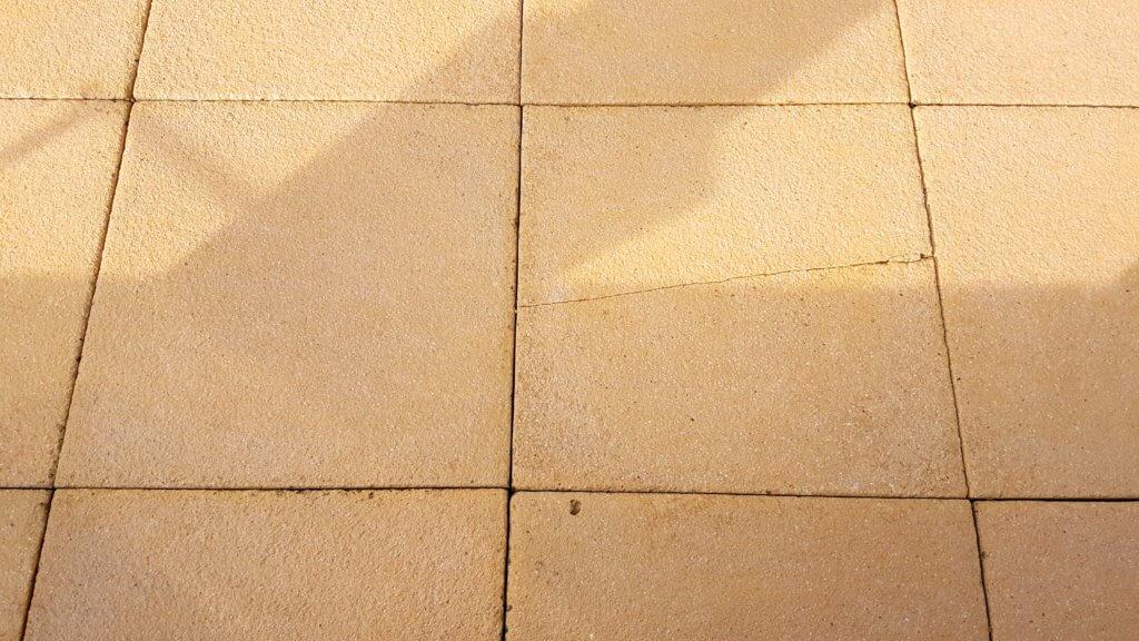 Lichen removal on patio slab